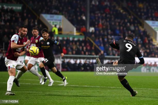 Gabriel Jesus of Manchester City scores the opening goal during the Premier League match between Burnley FC and Manchester City at Turf Moor on...