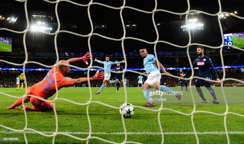 Gabriel Jesus of Manchester City scores the second City goal past Pepe Reina during the UEFA Champions League group F match between Manchester City and SSC Napoli at Etihad Stadium on October 17, 2017 in Manchester, United Kingdom.
