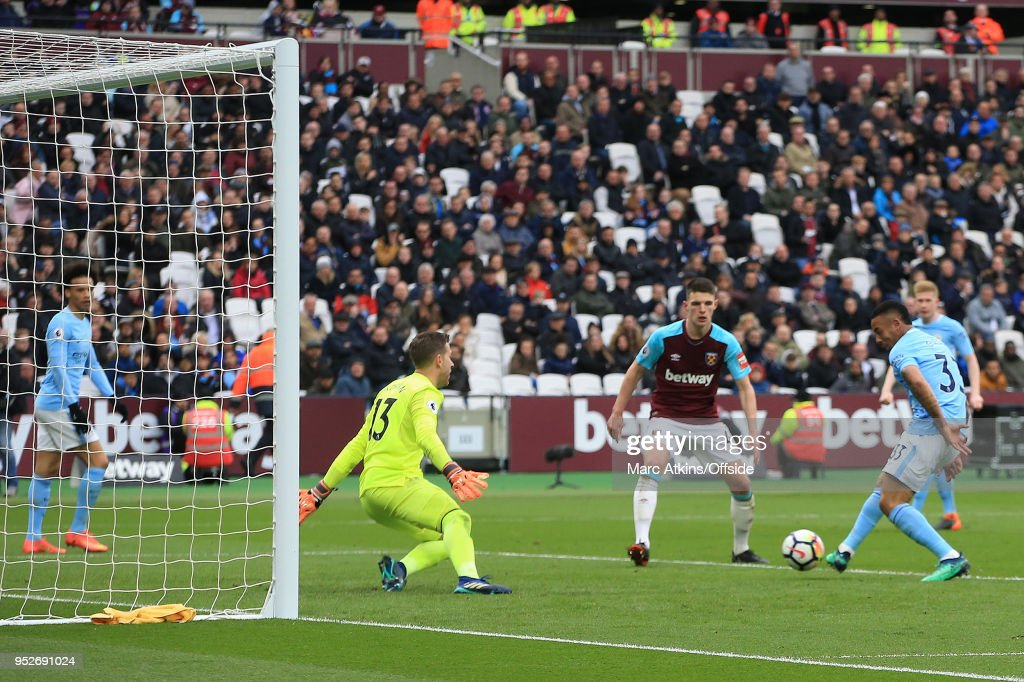 Gabriel Jesus of Manchester City scores their 3rd goal during the Premier League match between West Ham United and Manchester City at London Stadium on April 29, 2018 in London, England.