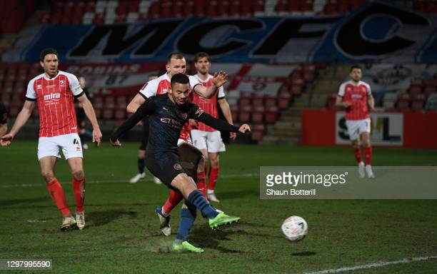 Gabriel Jesus of Manchester City scores their side's second goal during The Emirates FA Cup Fourth Round match between Cheltenham Town and Manchester...