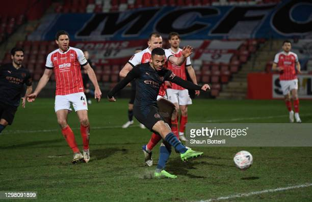 Gabriel Jesus of Manchester City scores their side's second goal during the The Emirates FA Cup Fourth Round match between Cheltenham Town and...