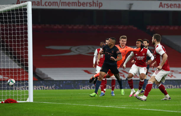 Gabriel Jesus of Manchester City scores their team's first goal during the Carabao Cup Quarter Final match between Arsenal and Manchester City at...