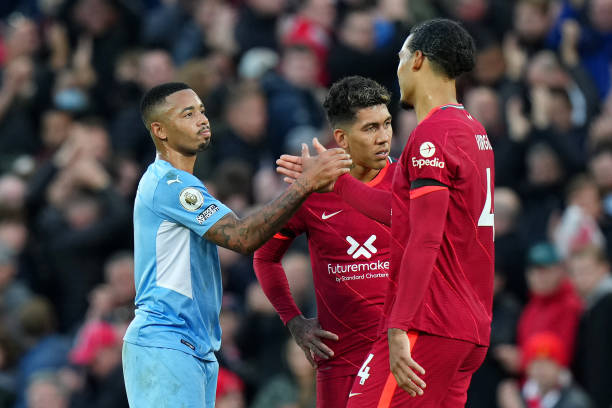 Gabriel Jesus of Manchester City shakes hands with Virgil van Dijk of Liverpool following the Premier League match between Liverpool and Manchester...