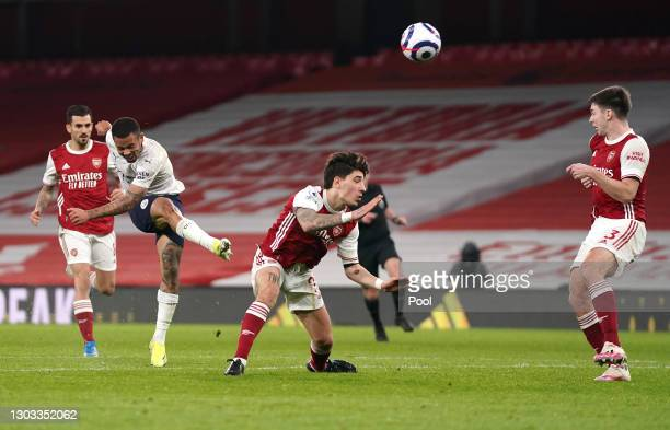 Gabriel Jesus of Manchester City shoots whilst under pressure from Hector Bellerin of Arsenal during the Premier League match between Arsenal and...