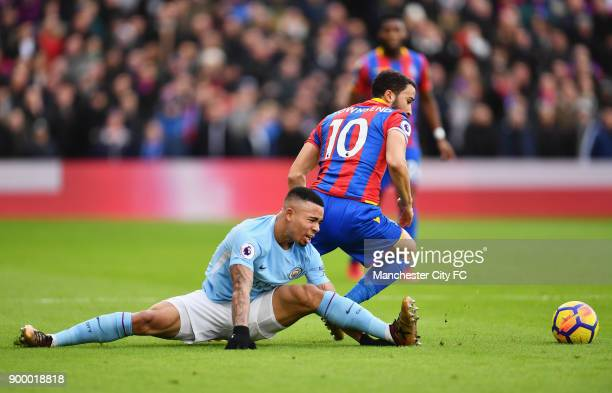 Gabriel Jesus of Manchester City stretches as he battles with Andros Townsend of Crystal Palace during the Premier League match between Crystal...