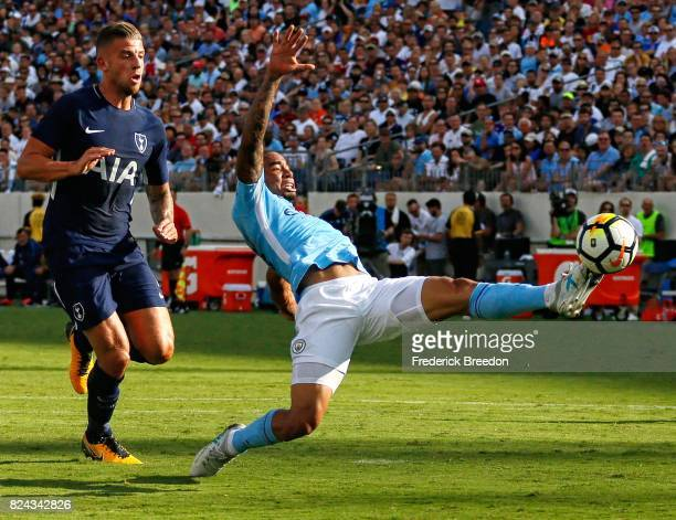 Gabriel Jesus of Manchester City stretches to kick the ball away from Ben Davies of Tottenham during the first half of the 2017 International...
