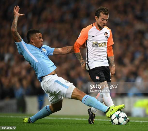Gabriel Jesus of Manchester City tackles Bernard of Shakhtar Donetsk during the UEFA Champions League Group F match between Manchester City and...