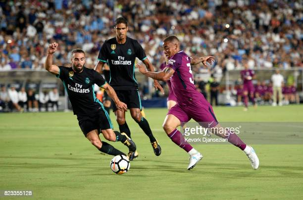 Gabriel Jesus of Manchester City takes a shot on gaol with defenders Daniel Carvajal and Casemiro of Real Madrid looking on during the first half of...