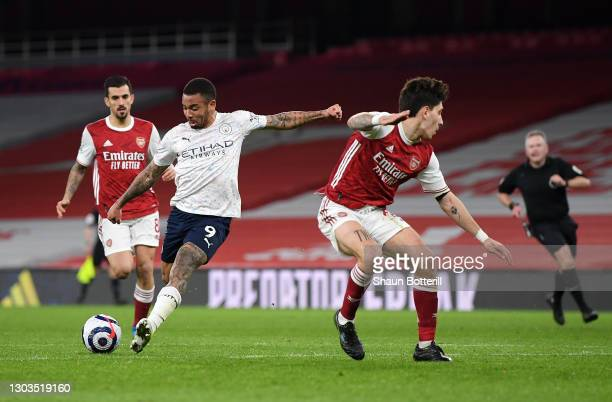 Gabriel Jesus of Manchester City takes a shot past Hector Bellerin of Arsenal during the Premier League match between Arsenal and Manchester City at...