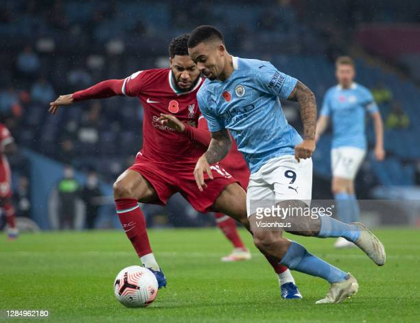 Gabriel Jesus of Manchester City takes on Joe Gomez of Liverpool during the Premier League match between Manchester City and Liverpool at the Etihad...