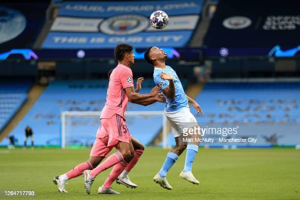 Gabriel Jesus of Manchester City takes on Raphael Varane of Real Madrid during the UEFA Champions League round of 16 second leg match between...