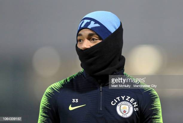 Gabriel Jesus of Manchester City wears a snood during a training session at Manchester City Football Academy on November 22 2018 in Manchester England