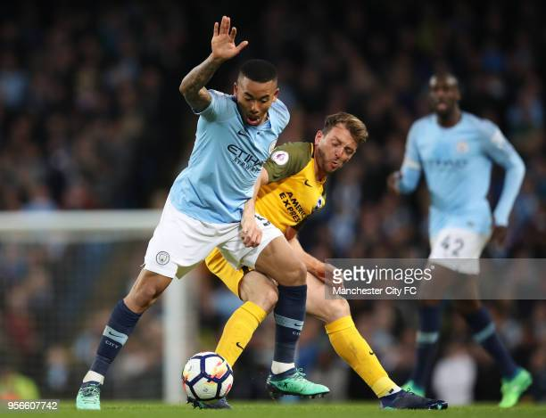 Gabriel Jesus of Manhester City is challenged by Dale Stephens of Brighton and Hove Albion during the Premier League match between Manchester City...