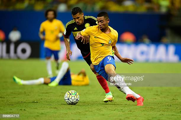 Gabriel Jesus player of Brazil competes for the ball with Jeison Murillo player of Colombia during 2018 FIFA World Cup Russia qualification match...