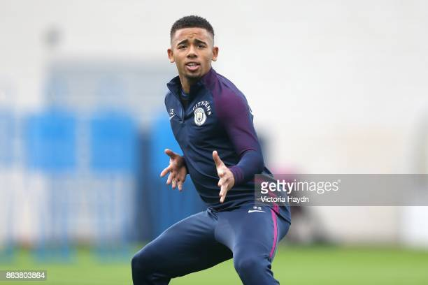 Gabriel Jesus reacts to the camera during training at Manchester City Football Academy on October 20 2017 in Manchester England