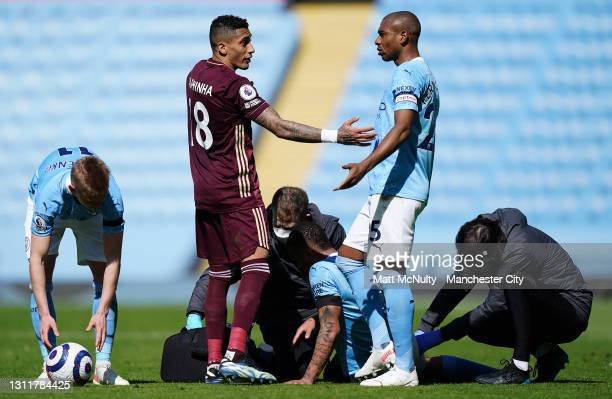 Gabriel Jesus receives treatment as Fernandinho and Oleksandr Zinchenko of Manchester City talk to Raphinha of Leeds United during the Premier League...