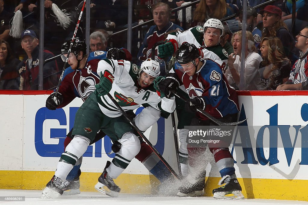Gabriel Landeskog #92 and Paul Stastny #26 of the Colorado Avalanche battle for control of the puck with Zach Parise #11 and Mikael Granlund #64 of the Minnesota Wild in Game Two of the First Round of the 2014 NHL Stanley Cup Playoffs at Pepsi Center on April 19, 2014 in Denver, Colorado. The Avalanche defeated the Wild 4-2 to take a 2-0 game lead in the series.