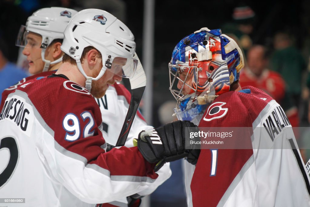 Gabriel Landeskog #92 and Semyon Varlamov #1 of the Colorado Avalanche celebrate after defeating the Minnesota Wild at the Xcel Energy Center on March 13, 2018 in St. Paul, Minnesota.
