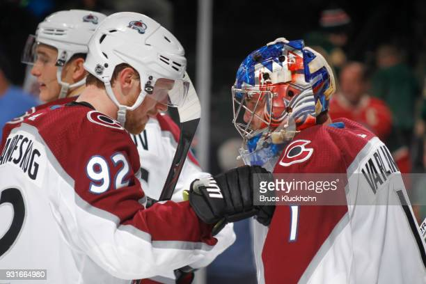 Gabriel Landeskog and Semyon Varlamov of the Colorado Avalanche celebrate after defeating the Minnesota Wild at the Xcel Energy Center on March 13...