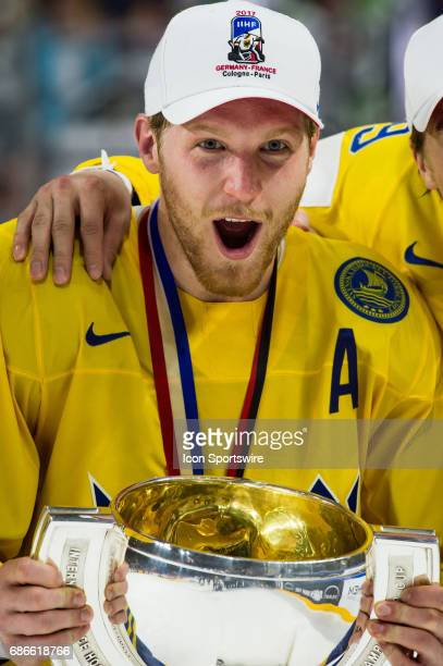 Gabriel Landeskog celebrates with the trophy during the Ice Hockey World Championship Gold medal game between Canada and Sweden at Lanxess Arena in...