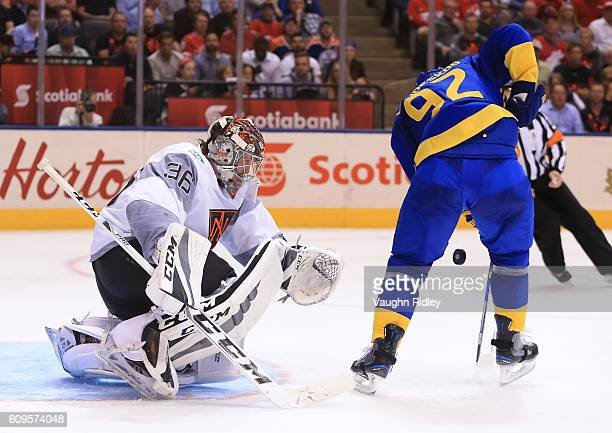 Gabriel Landeskog of Team Sweden jumps on a loose puck in front of John Gibson of Team North America during the World Cup of Hockey 2016 at Air...