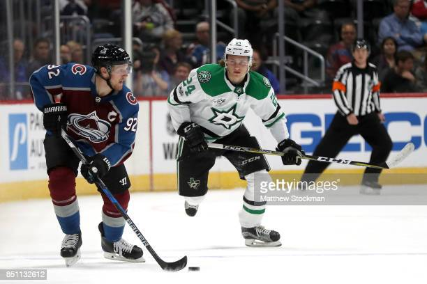 Gabriel Landeskog of the Colorado Avalanche advances the puck against Roope Hintz of the Dallas Stars at the Pepsi Center on September 21 2017 in...