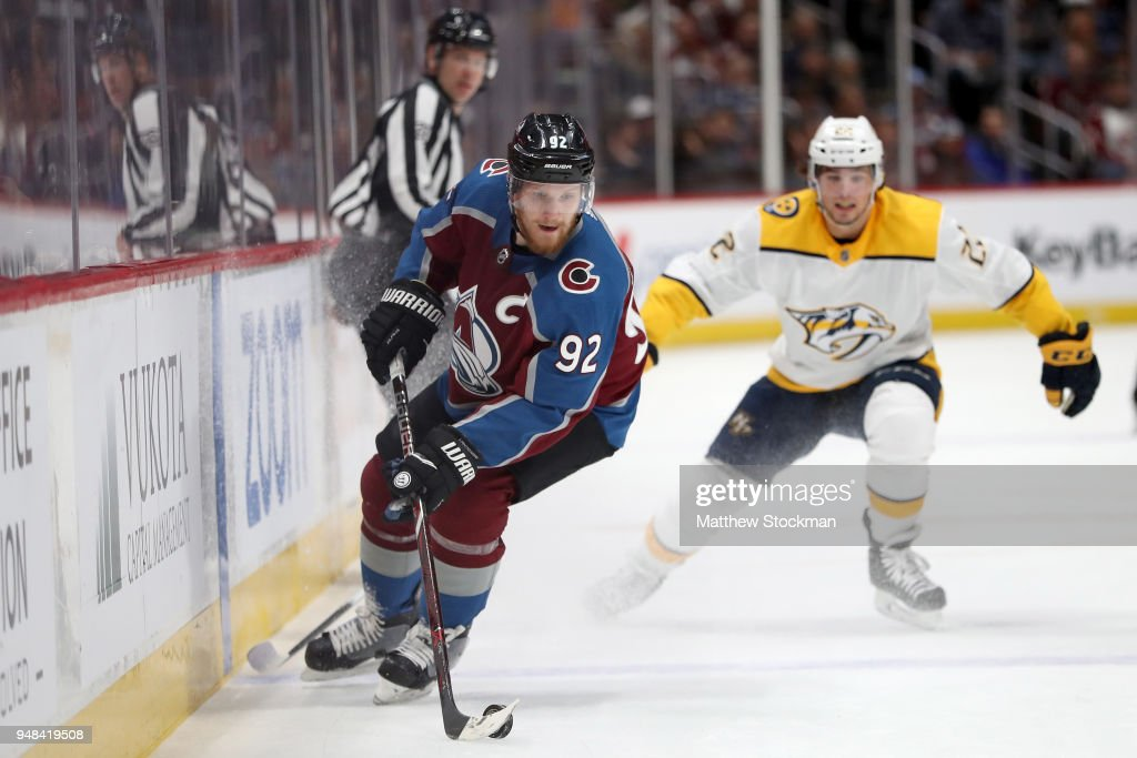 Gabriel Landeskog #92 of the Colorado Avalanche advances the puck against the Nashville Predators in Game Four of the Western Conference First Round during the 2018 NHL Stanley Cup Playoffs at the Pepsi Center on April 18, 2018 in Denver, Colorado.