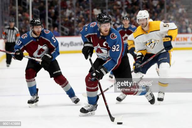 Gabriel Landeskog of the Colorado Avalanche advances the puck against the Nashville Predators in Game Six of the Western Conference First Round...