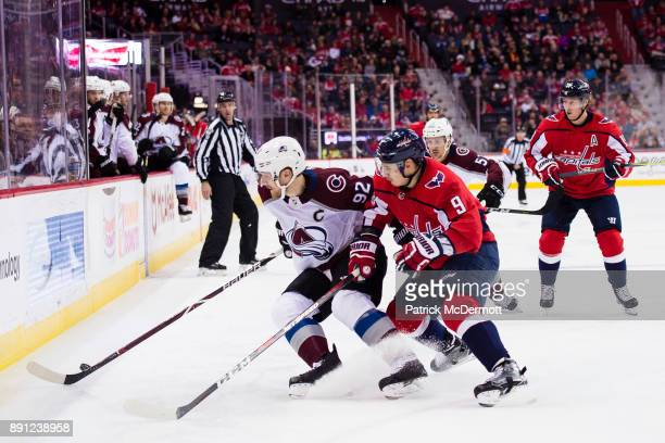 Gabriel Landeskog of the Colorado Avalanche and Dmitry Orlov of the Washington Capitals battle for the puck in the second period at Capital One Arena...