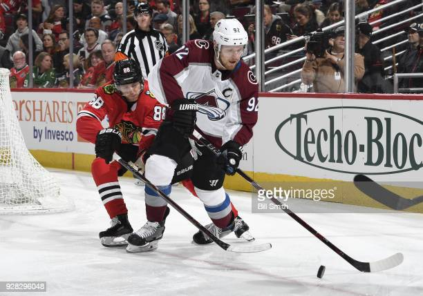 Gabriel Landeskog of the Colorado Avalanche and Patrick Kane of the Chicago Blackhawks chase the puck in the first period at the United Center on...