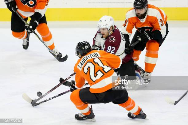 Gabriel Landeskog of the Colorado Avalanche and Scott Laughton of the Philadelphia Flyers go after the puck during the first period at Wells Fargo...