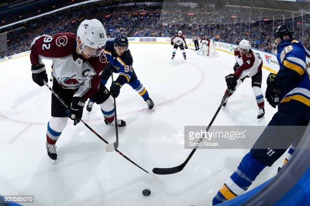 Gabriel Landeskog of the Colorado Avalanche and Tyson Barrie of the Colorado Avalanche defend against Nikita Soshnikov of the St Louis Blues at...