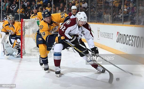Gabriel Landeskog of the Colorado Avalanche battles against Roman Josi of the Nashville Predators during an NHL game at Bridgestone Arena on February...