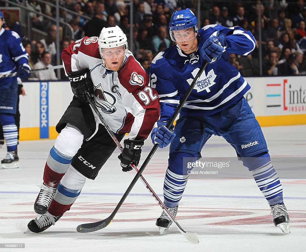 Gabriel Landeskog #92 of the Colorado Avalanche battles against Tyler Bozak #42 of the Toronto Maple Leafs during an NHL game at the Air Canada Centre on October 8, 2013 in Toronto, Ontario, Canada. The Avalanche defeated the Leafs 2-1.