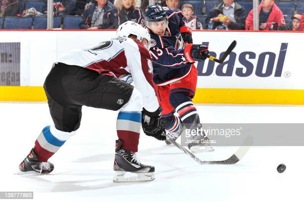 Gabriel Landeskog of the Colorado Avalanche breaks his stick while attempting to block the shot from Cam Atkinson of the Columbus Blue Jackets during...