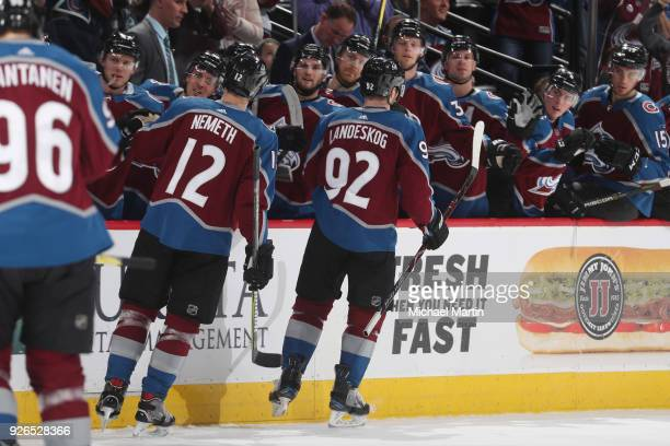 Gabriel Landeskog of the Colorado Avalanche celebrates a goal against the Minnesota Wild with his bench at the Pepsi Center on March 2 2018 in Denver...