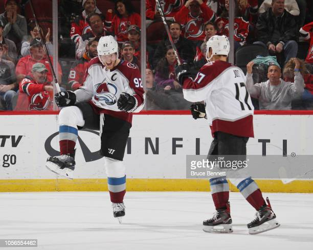 Gabriel Landeskog of the Colorado Avalanche celebrates his goal at 808 of the third period against the New Jersey Devils and is joined by Tyson Jost...