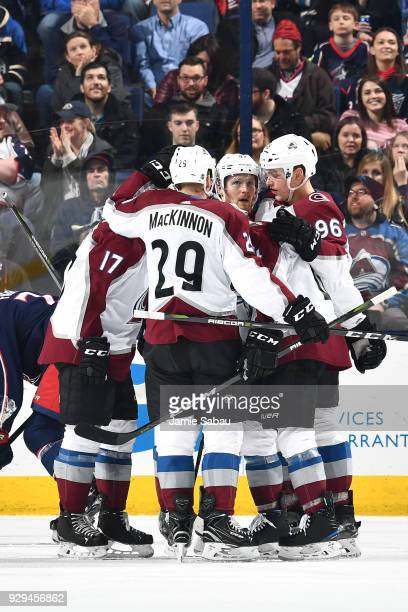 Gabriel Landeskog of the Colorado Avalanche celebrates his third period goal with his teammates during a game against the Columbus Blue Jackets on...