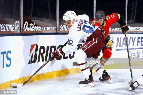 Gabriel Landeskog of the Colorado Avalanche controls the puck in front of Zach Whitecloud of the Vegas Golden Knights during the third period during...