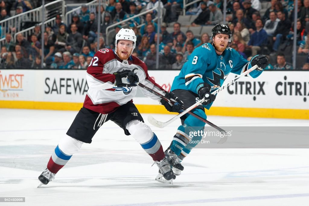 Gabriel Landeskog #92 of the Colorado Avalanche defends Joe Pavelski #8 of the San Jose Sharks at SAP Center on April 5, 2018 in San Jose, California.