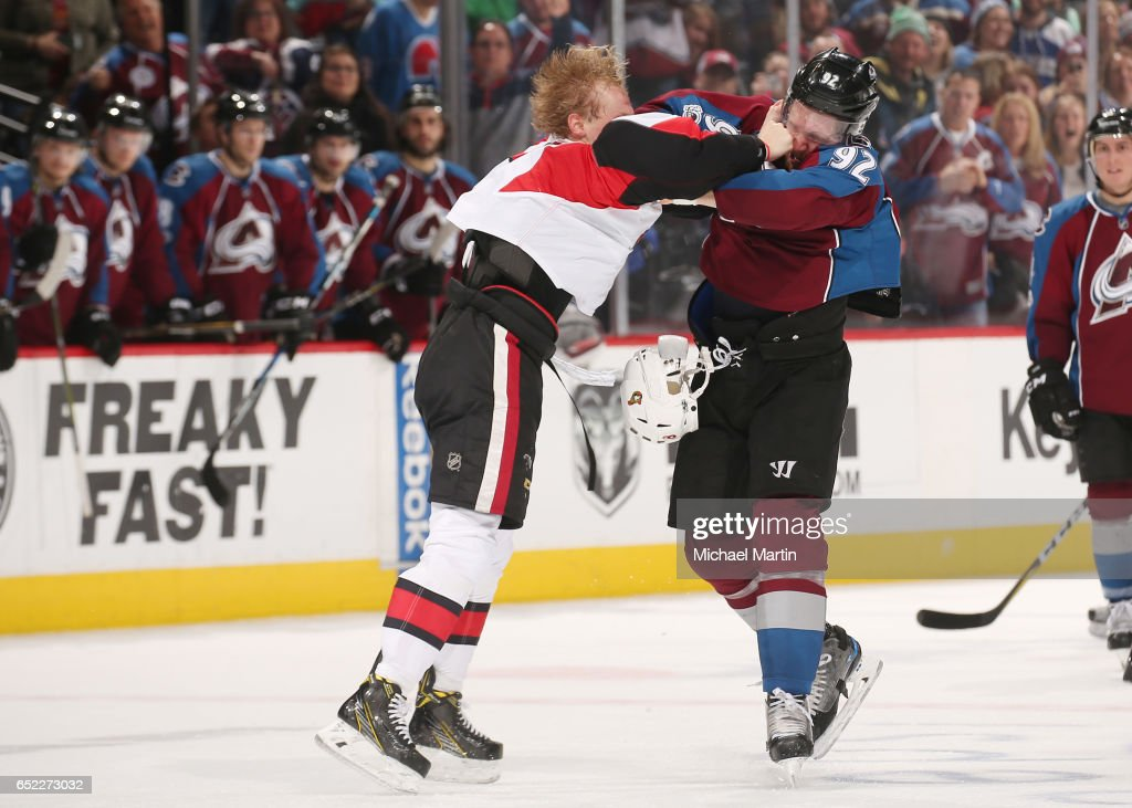 Gabriel Landeskog #92 of the Colorado Avalanche fights against Ryan Dzingel #18 of the Ottawa Senators at the Pepsi Center on March 11, 2017 in Denver, Colorado. The Senators defeated the Avalanche 4-2.