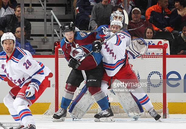 Gabriel Landeskog of the Colorado Avalanche fights for position against Ryan McDonagh goaltender Cam Talbot and Dominic Moore of the New York Rangers...