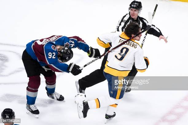Gabriel Landeskog of the Colorado Avalanche gets physical with Filip Forsberg of the Nashville Predators during the third period of Colorado's 53 win...