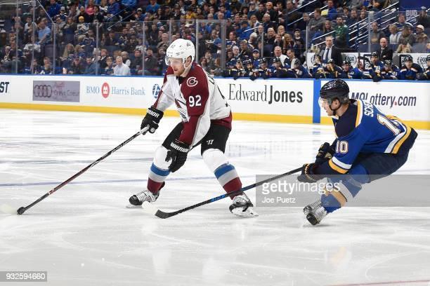 Gabriel Landeskog of the Colorado Avalanche handles the puck as Brayden Schenn of the St Louis Blues pressures at Scottrade Center on March 15 2018...