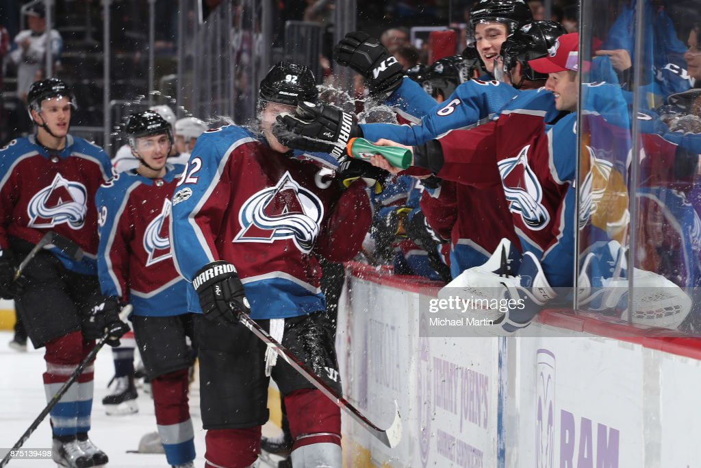 Gabriel Landeskog #92 of the Colorado Avalanche is doused with water by teammate goaltender Jonathan Bernier #45 after scoring his third goal of the game against the Washington Capitals at the Pepsi Center on November 16, 2017 in Denver, Colorado. The Avalanche defeated the Capitals 6-2.