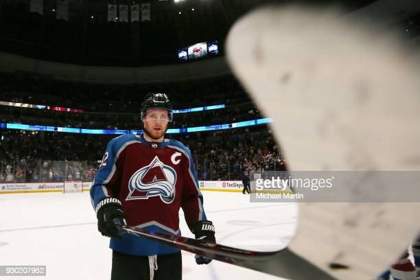 Gabriel Landeskog of the Colorado Avalanche points his stick at the camera after the victory against the Arizona Coyotes at the Pepsi Center on March...
