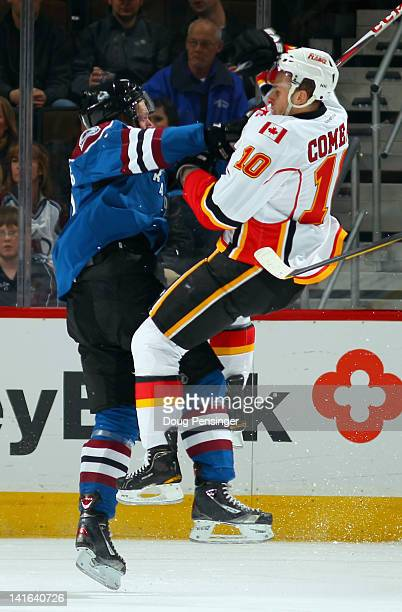 Gabriel Landeskog of the Colorado Avalanche puts a hit on Blake Comeau of the Calgary Flames at Pepsi Center on March 20 2012 in Denver Colorado