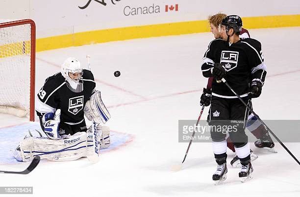 Gabriel Landeskog of the Colorado Avalanche scores a goal against goaltender Mathieu Garon of the Los Angeles Kings as Alec Martinez of the Kings...