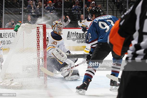Gabriel Landeskog of the Colorado Avalanche scores a goal against goaltender Ryan Miller the Buffalo Sabres at the Pepsi Center on February 1 2014 in...