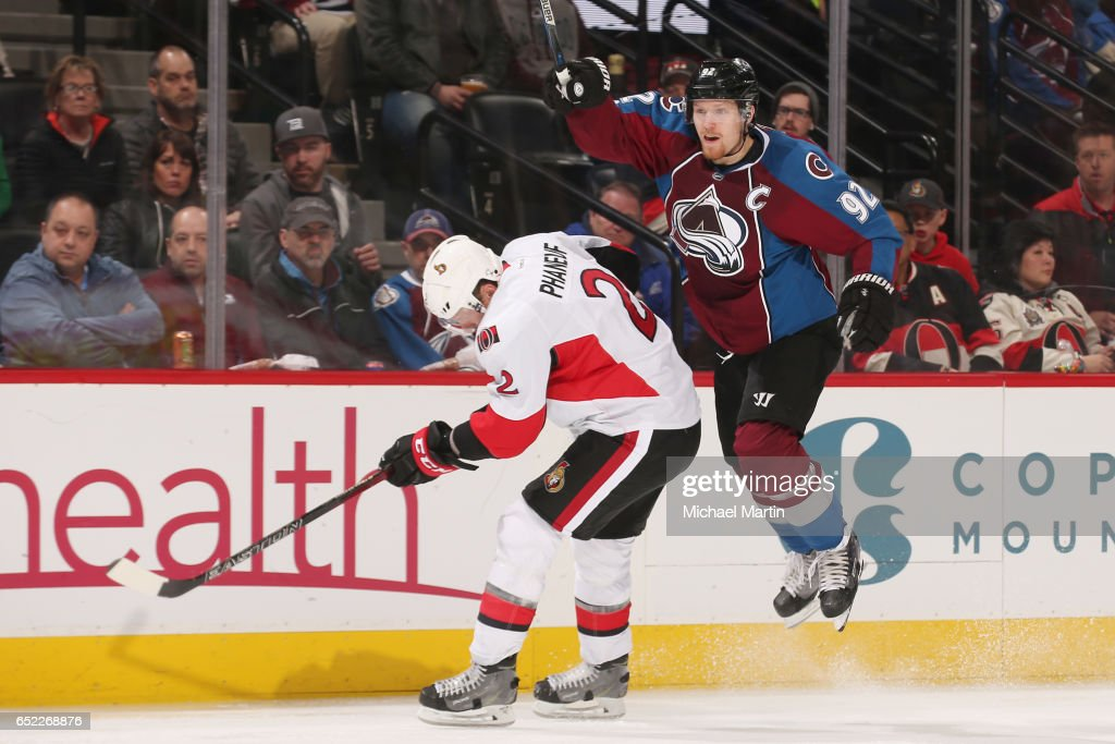 Gabriel Landeskog #92 of the Colorado Avalanche skates around Dion Phaneuf #2 of the Ottawa Senators at the Pepsi Center on March 11, 2017 in Denver, Colorado. The Senators defeated the Avalanche 4-2.